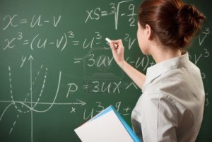 7042592-girl-writing-the-mathematical-formulas-on-a-chalkboard