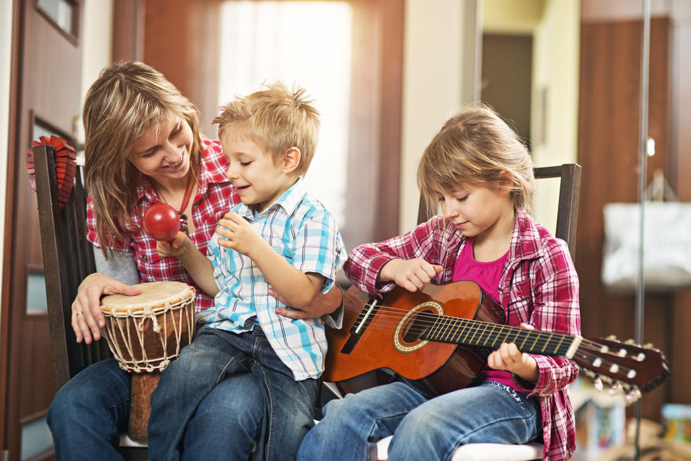 Mother and kids playing music together